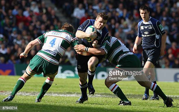 Brian O'Driscoll of Leinster is tackled by Tom Croft of Leicester Tigers during the Heineken Cup Final match between Leicester Tigers and Leinster at...
