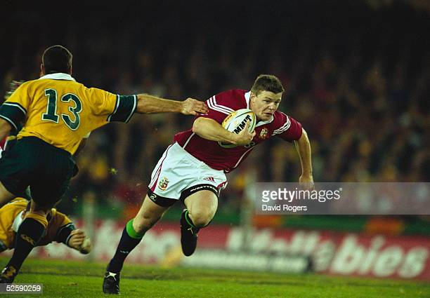 Brian O'Driscoll of the British Lions takes the ball past Daniel Herbert of Australia during the British and Irish Lions tour match between Australia...