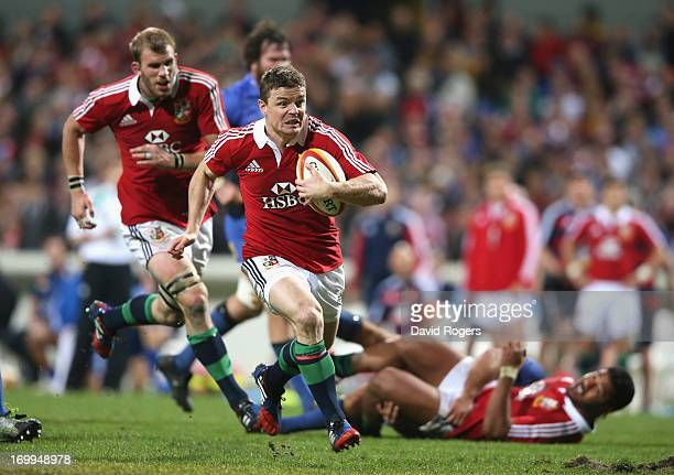 Brian O'Driscoll of the Lions breaks clear to score his second try during the tour match between the Western Force and the British Irish Lions at...