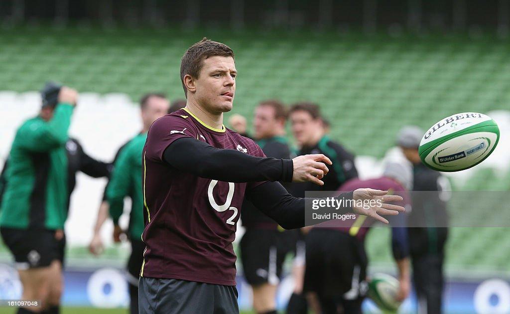 Brian O'Driscoll passes the ball during the Ireland captain's run at the Aviva Stadium on February 9, 2013 in Dublin, Ireland.