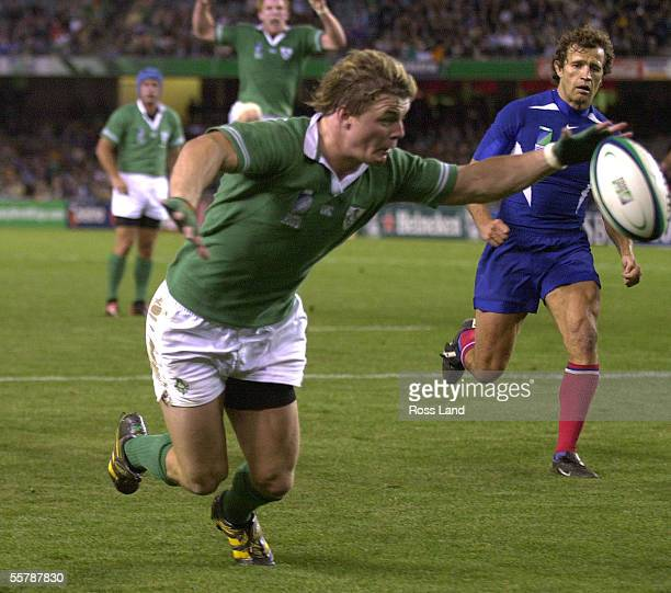 Brian O'Driscoll reaches out to touch the ball down for the second of his two tries as French captain Fabien Galthie looks on during the France V...