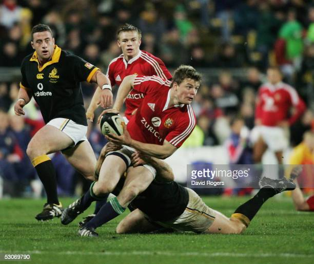 Brian O'Driscoll the Lions captain prepares to pass the ball during the match between the British and Irish Lions and Wellington at The Westpac...