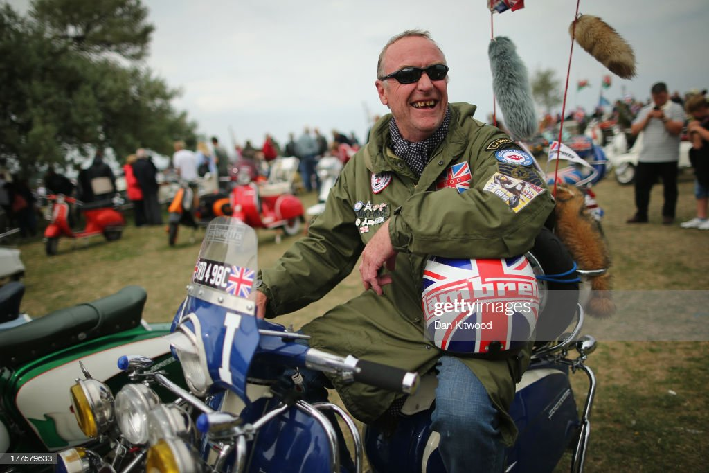 Brian Oldrey sits on his Lambretta LI Special 150cc during the 'Scooter Rally' on the Esplanade on August 24, 2013 in Ryde, England. Approximately 6000 riders bring their scooters to take part in the event, which is organized by the British Scooter Rally Association and The VFM Scooter Collective, and has been running since 1980.