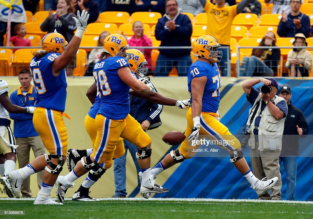 Brian O'Neill #70 of the Pittsburgh Panthers rushes for a 24-yard touchdown in the first half during the game against the Georgia Tech Yellow Jackets on October 8, 2016 at Heinz Field in Pittsburgh, Pennsylvania.