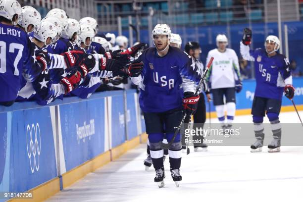 Brian O'Neill of the United States celebrates after scoring a goal on Gasper Kroselj of Slovenia in the first period during the Men's Ice Hockey...
