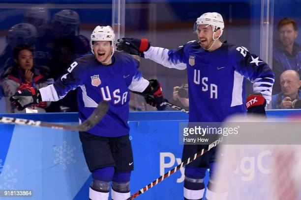 Brian O'Neill of the United States celebrates with teammate Jonathon Blum after scoring a goal on Gasper Kroselj of Slovenia in the first period...