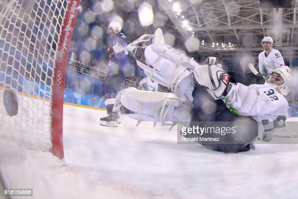 Brian O'Neill of the United States scores a goal on Gasper Kroselj of Slovenia in the first period during the Men's Ice Hockey Preliminary Round...
