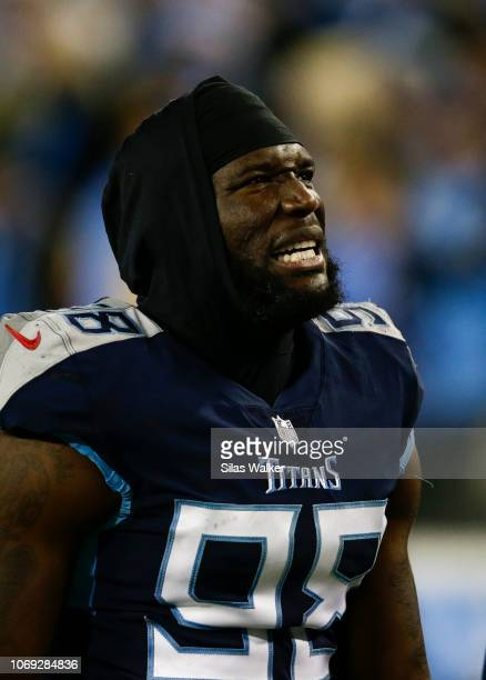 Brian Orakpo of the Tennessee Titans grimices in pain while waling off the field after being injured during the fourth quarter against the...