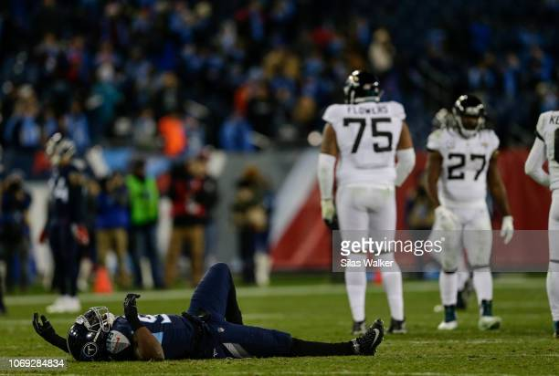 Brian Orakpo of the Tennessee Titans lays on the ground after being injured during a play in the fourth quarter against the Jacksonville Jaguars at...