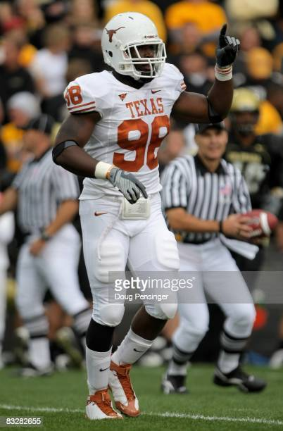 Brian Orakpo of the Texas Longhorns leaves the field between plays against the Colorado Buffaloes at Folsom Field on October 4 2008 in Boulder...