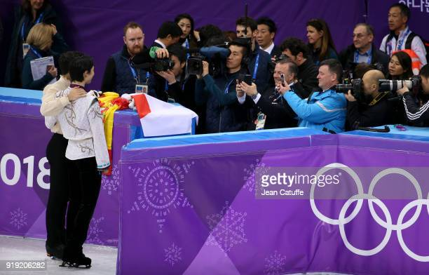 Brian Orser coach of both gold medalist Yuzuru Hanyu and bronze medalist Javier Fernandez of Spain take their picture during the victory ceremony...