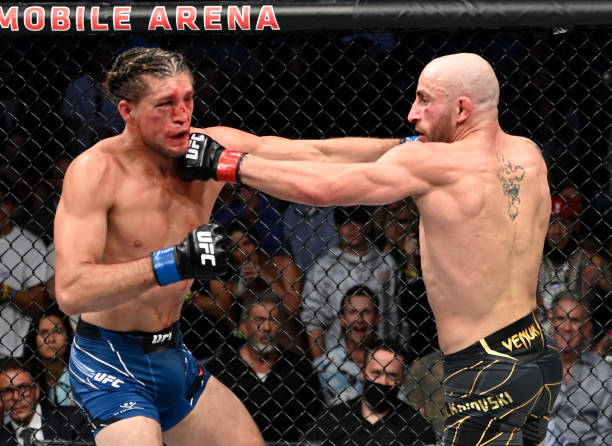 Brian Ortega and Alexander Volkanovski of Australia trade punches in their UFC featherweight championship fight during the UFC 266 event on September...