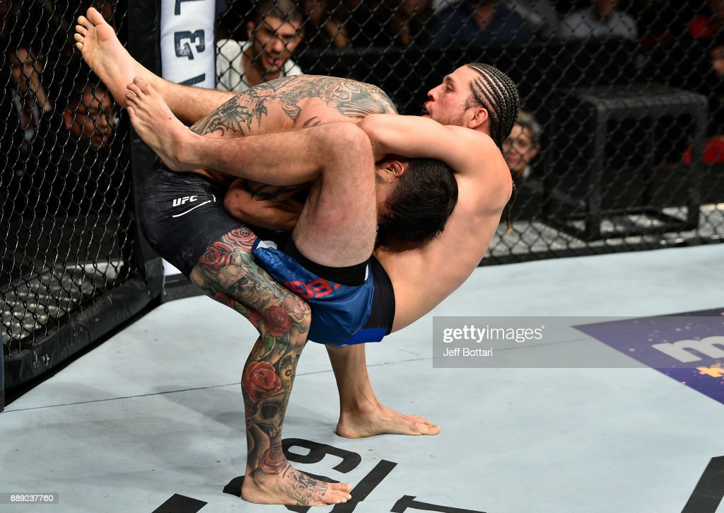 Brian Ortega attempts to submit Cub Swanson in their featherweight bout during the UFC Fight Night event inside Save Mart Center on December 9, 2017 in Fresno, California.