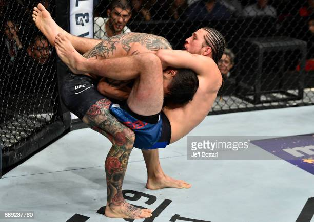 Brian Ortega attempts to submit Cub Swanson in their featherweight bout during the UFC Fight Night event inside Save Mart Center on December 9, 2017...
