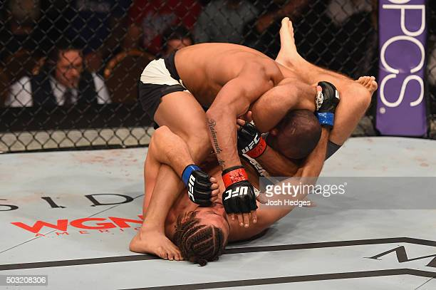 Brian Ortega attempts to submit Diego Brandao of Brazil in their featherweight bout during the UFC 195 event inside MGM Grand Garden Arena on January...