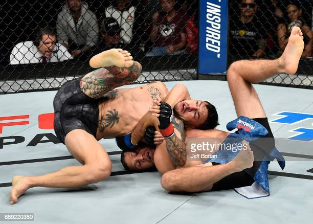 Brian Ortega attempts to submit in their featherweight bout during the UFC Fight Night event inside Save Mart Center on December 9 2017 in Fresno...