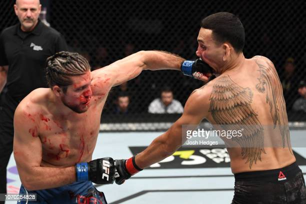 Brian Ortega punches Max Holloway in their UFC featherweight championship fight during the UFC 231 event at Scotiabank Arena on December 8 2018 in...
