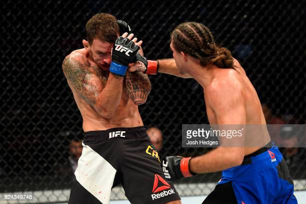 Brian Ortega punches Renato Moicano of Brazil in their featherweight bout during the UFC 214 event at Honda Center on July 29 2017 in Anaheim...