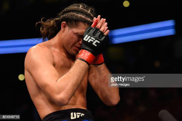 Brian Ortega reacts after defeating Renato Moicano of Brazil in their featherweight bout during the UFC 214 event at Honda Center on July 29 2017 in...