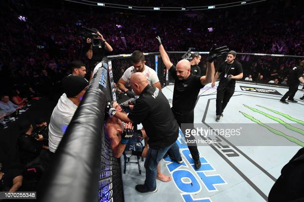 Brian Ortega reacts to his doctor stoppage loss to Max Holloway in their UFC featherweight championship fight during the UFC 231 event at Scotiabank...