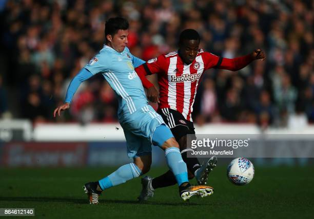 Brian Oviedo of Sunderland tackles with Florian Jozefzoon of Brentford during the Sky Bet Championship match between Brentford and Sunderland at...