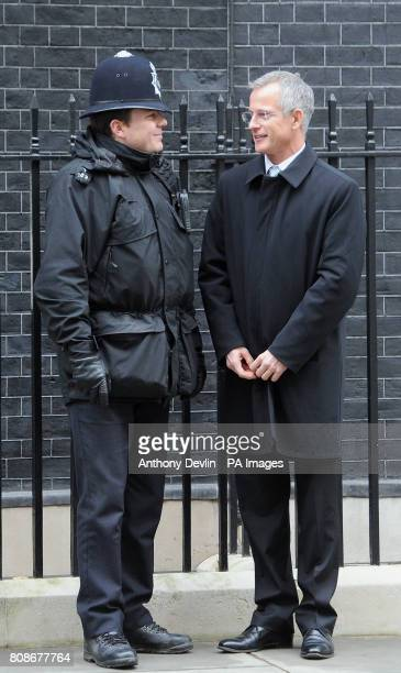 Brian Paddock speaks with a police officer as he leaves after a cabinet meeting at 10 Downing Street London