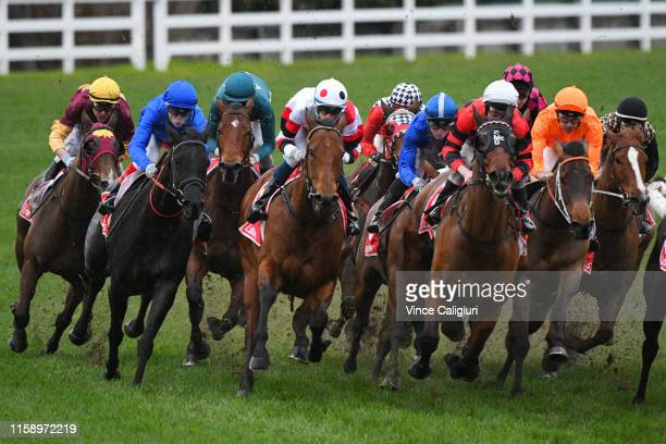 Brian Park riding Miss Iano makes a sweeping run outside on the home turn before winning Race 8 during Melbourne Racing at Caulfield Racecourse on...