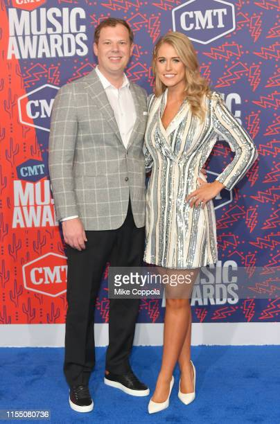 Brian Parker and Jillian Cardarelli attend the 2019 CMT Music Awards at Bridgestone Arena on June 05 2019 in Nashville Tennessee