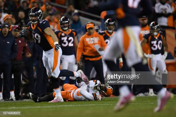 Brian Parker of the Denver Broncos breaks a tackle during the first quarter against the Cleveland Browns The Denver Broncos hosted the Cleveland...