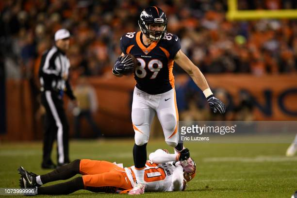 Brian Parker of the Denver Broncos is held by Briean BoddyCalhoun of the Cleveland Browns during the first quarter The Denver Broncos hosted the...