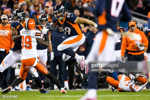Brian Parker of the Denver Broncos leaps over Briean BoddyCalhoun of the Cleveland Browns during the first half on Saturday December 15 2018