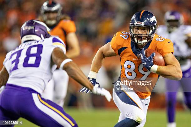 Brian Parker of the Denver Broncos runs the ball after catching a pass during a game against the Minnesota Vikings during week one of the preseason...