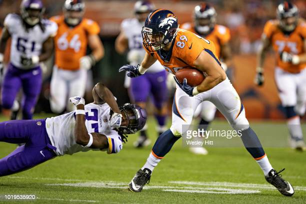 Brian Parker of the Denver Broncos shuns the tackle attempt by Holton Hill of the Minnesota Vikings during week one of the preseason at Broncos...