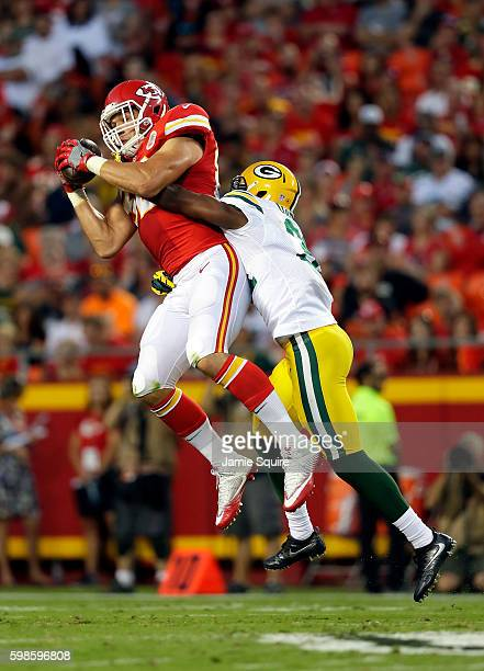 Brian Parker of the Kansas City Chiefs catches a pass a Robertson Daniel of the Green Bay Packers defends during the preseason game at Arrowhead...
