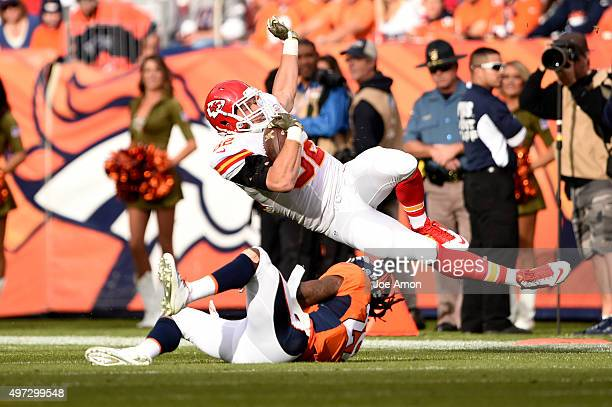 Brian Parker of the Kansas City Chiefs picks up 6 yards before being tripped up by Bradley Roby of the Denver Broncos in the first quarter The...