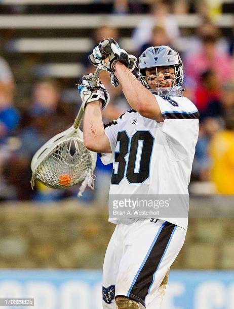 Brian Phipps of the Ohio Machine looks to pass the ball during first half action against the Charlotte Hounds at American Legion Memorial Stadium on...
