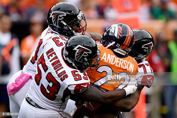 Brian Poole of the Atlanta Falcons LaRoy Reynolds and Ra'Shede Hageman stop CJ Anderson of the Denver Broncos during the fourth quarter of the...