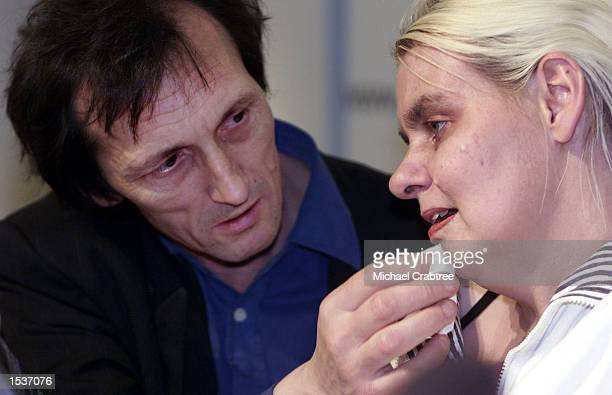Brian Pretty wipes tears from the face of his terminally ill wife Diane during a press conference about the decision by the European Court of Human...