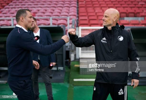Brian Priske, head coach of FC Midtjylland and Stale Solbakken, head coach of FC Copenhagen shake hands prior to the Danish 3F Superliga match...