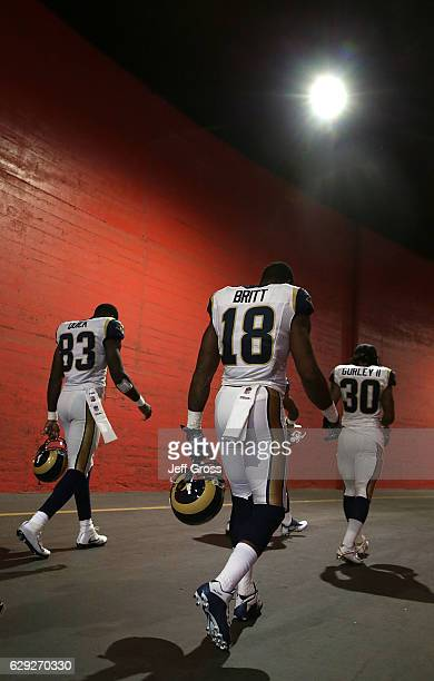 Brian Quick Kenny Britt and Todd Gurley of the Los Angeles Rams walk down the tunnel prior to the start of the game against the Atlanta Falcons at...