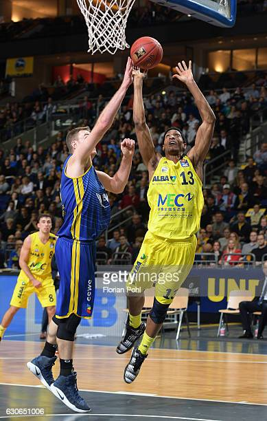 Brian Qvale of the EWE Baskets Oldenburg and Malcolm Miller of Alba Berlin during the game between Alba Berlin and EWE Baskets Oldenburg on december...