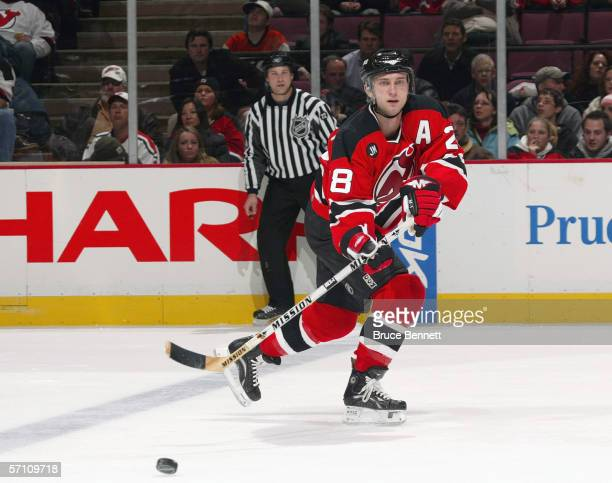 Brian Rafalski of the New Jersey Devils passes the puck against the Philadelphia Flyers on March 1 2006 at the Continental Airlines Arena in East...