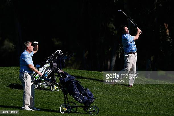 Brian Rimmer of Little Aston Golf Club plays a shot watched by team mate Geoffrey Hands during day one of The Golfplan Insurance Pro Captain...