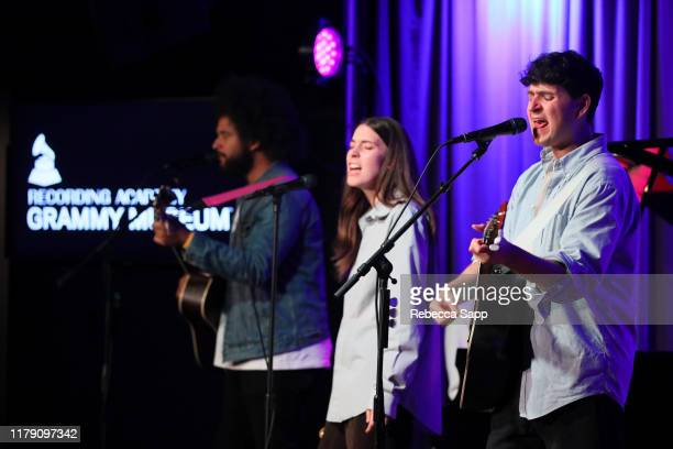 Brian Robert Jones Danielle Haim and Ezra Koenig perform at The Drop Vampire Weekend on October 04 2019 in Los Angeles California