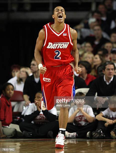 Brian Roberts of Dayton Flyers celebrates after making a shot during the game against the Louisville Cardinals at Freedom Hall December 8 2007 in...