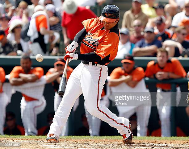 Brian Roberts of the Baltimore Orioles fouls off a pitch against the Boston Red Sox during a Grapefruit League Spring Training Game at Ed Smith...