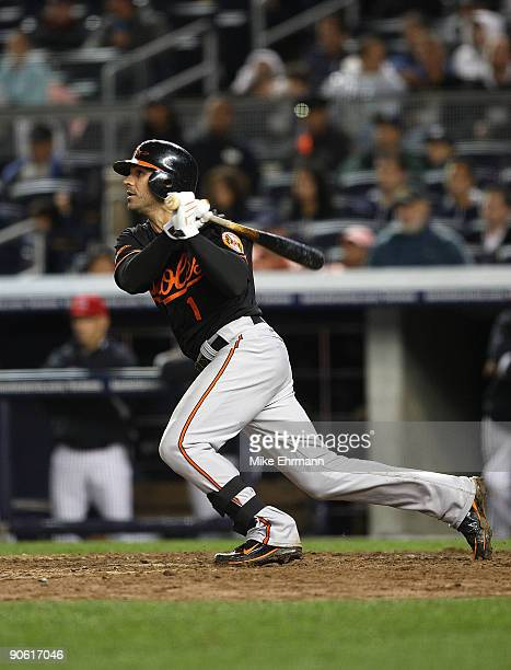 Brian Roberts of the Baltimore Orioles hits a 2 RBI single during a game against the New York Yankees at Yankee Stadium on September 11 2009 in the...