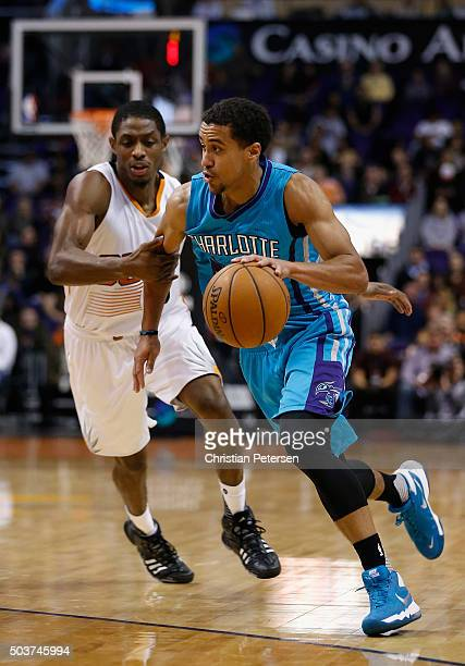 Brian Roberts of the Charlotte Hornets drives the ball past Brandon Knight of the Phoenix Suns during the first half of the NBA game at Talking Stick...