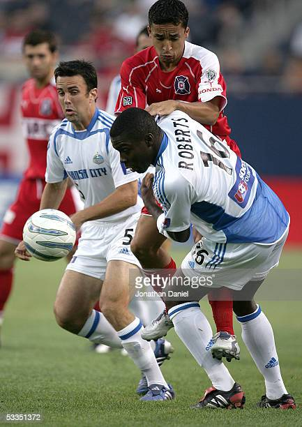 Brian Roberts of the Kansas City Wizards battles with Ivan Guerrero of the Chicago Fire as teammate Kerry Zavagnin backs him up on defense on August...
