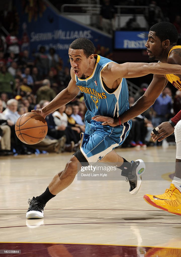 Brian Roberts #22 of the New Orleans Hornets drives to the hoop against Kyrie Irving #2 of the Cleveland Cavaliers at The Quicken Loans Arena on February 20, 2013 in Cleveland, Ohio.